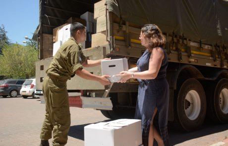 שכנות טובה: תושבי הגולן מעבירים ציוד ומזון למחנות האוהלים בסוריה